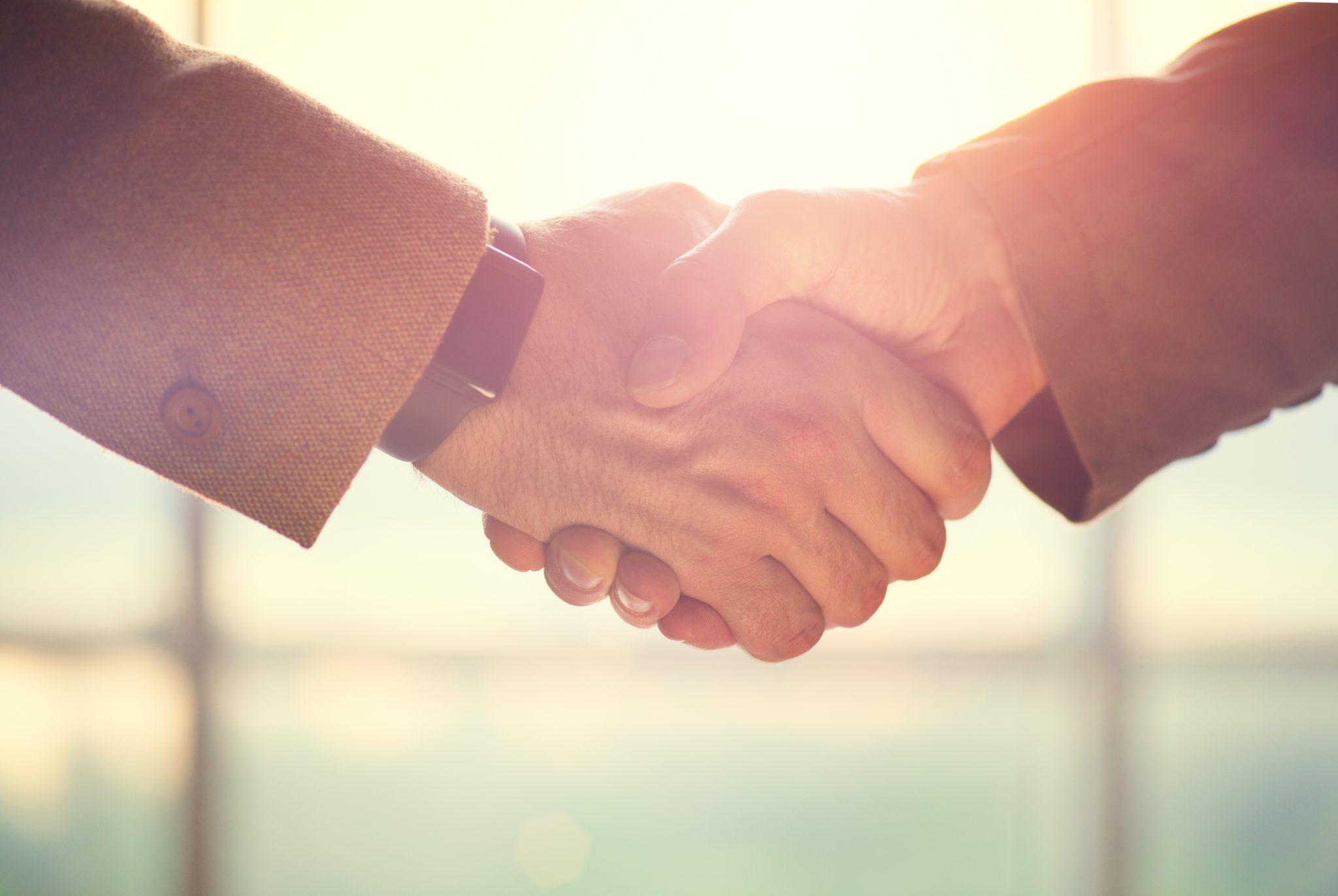 bigstock-Business-handshake-Business-h-126104462