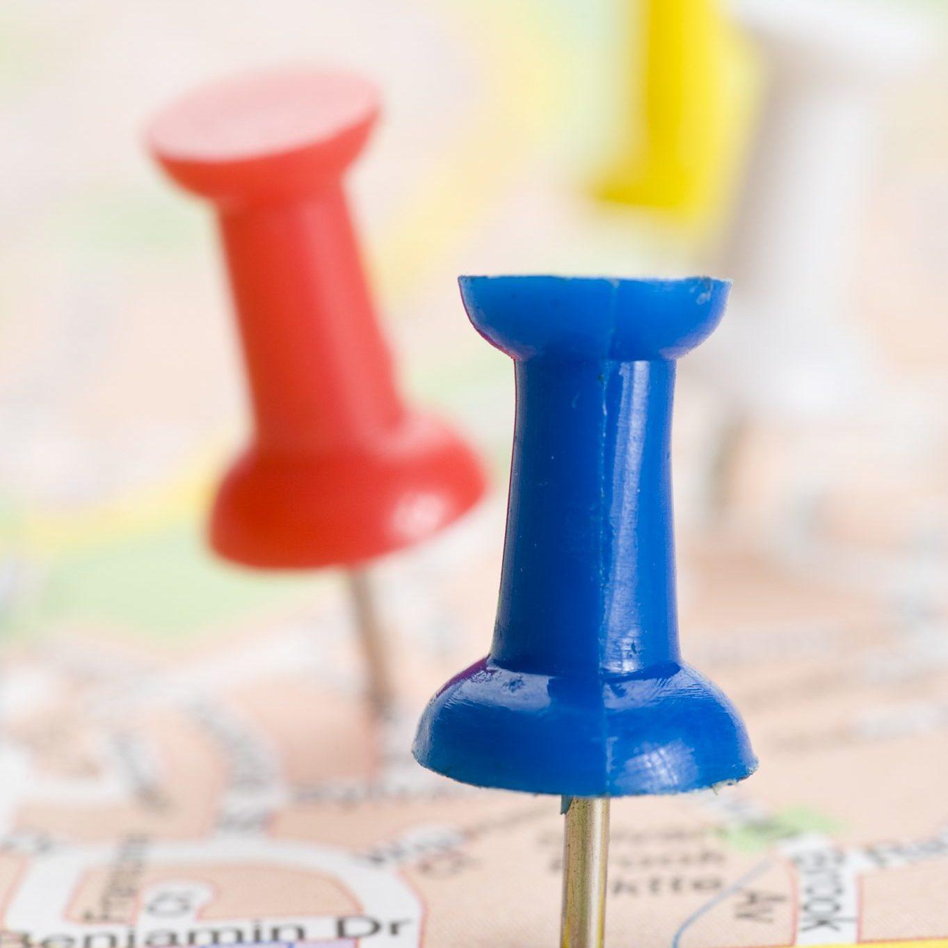 bigstock-Pushpins-marking-a-location-on-23009036